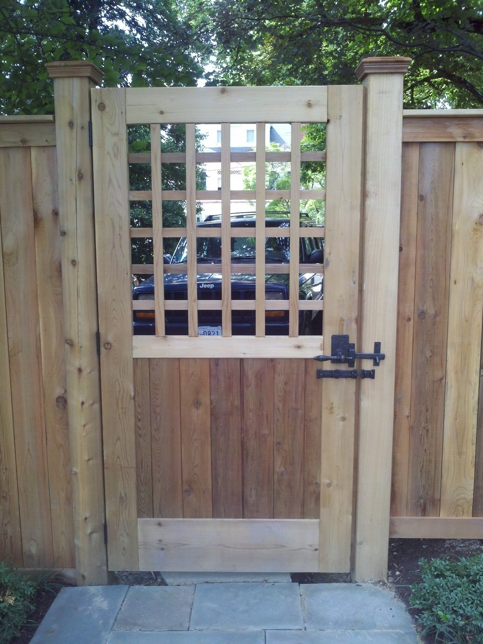 Dark Bronze Lever Latch with Rounded Handle on wood gate